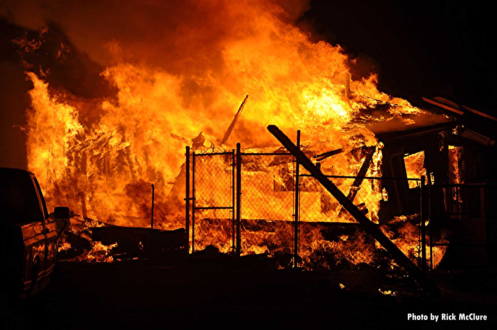 Remains of a building amid flames