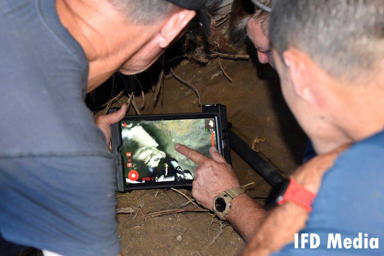 Firefighters use rescue camera to locate dog
