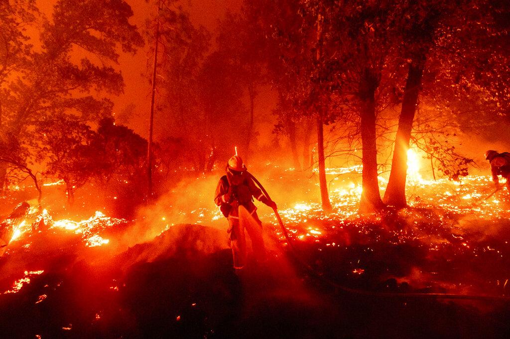 Firefighter battles the Creek Fire