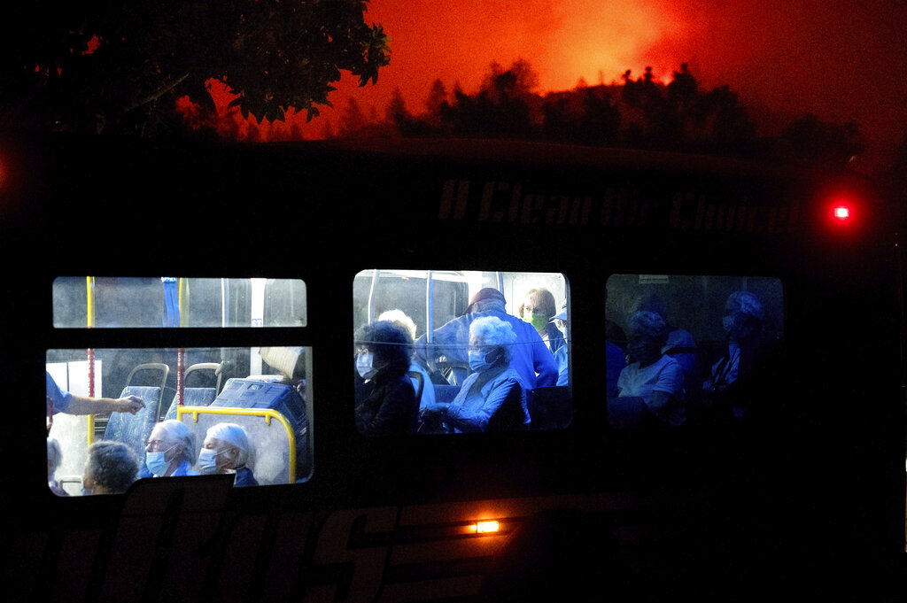 Residents of the Oakmont Gardens senior home evacuate by bus