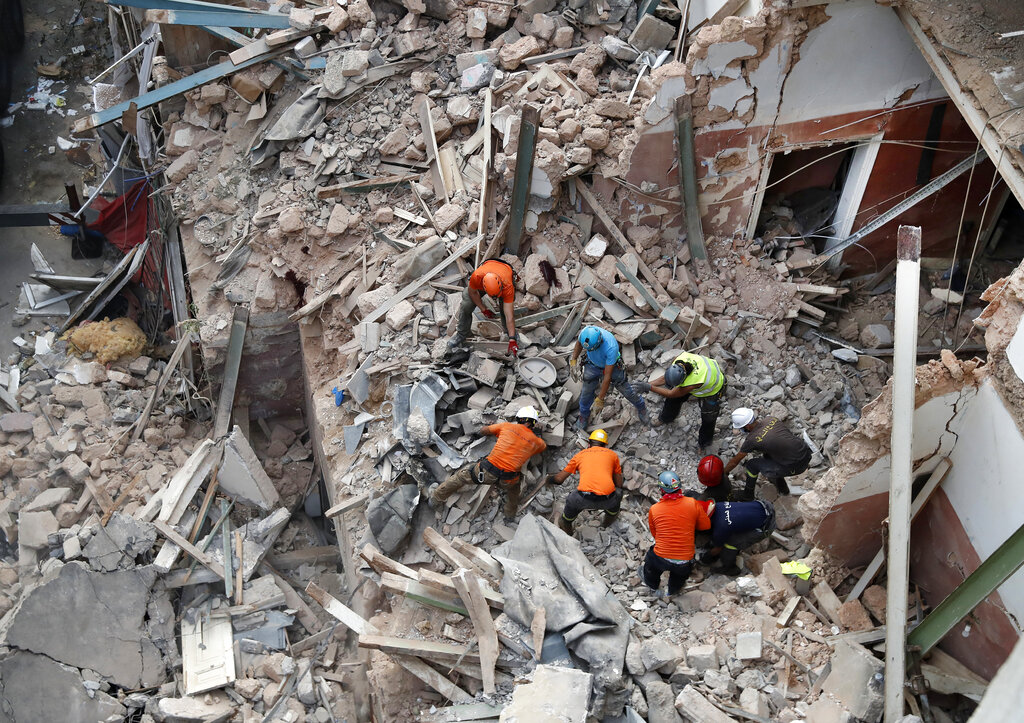 Searchers work amid the rubble after Beirut explosion