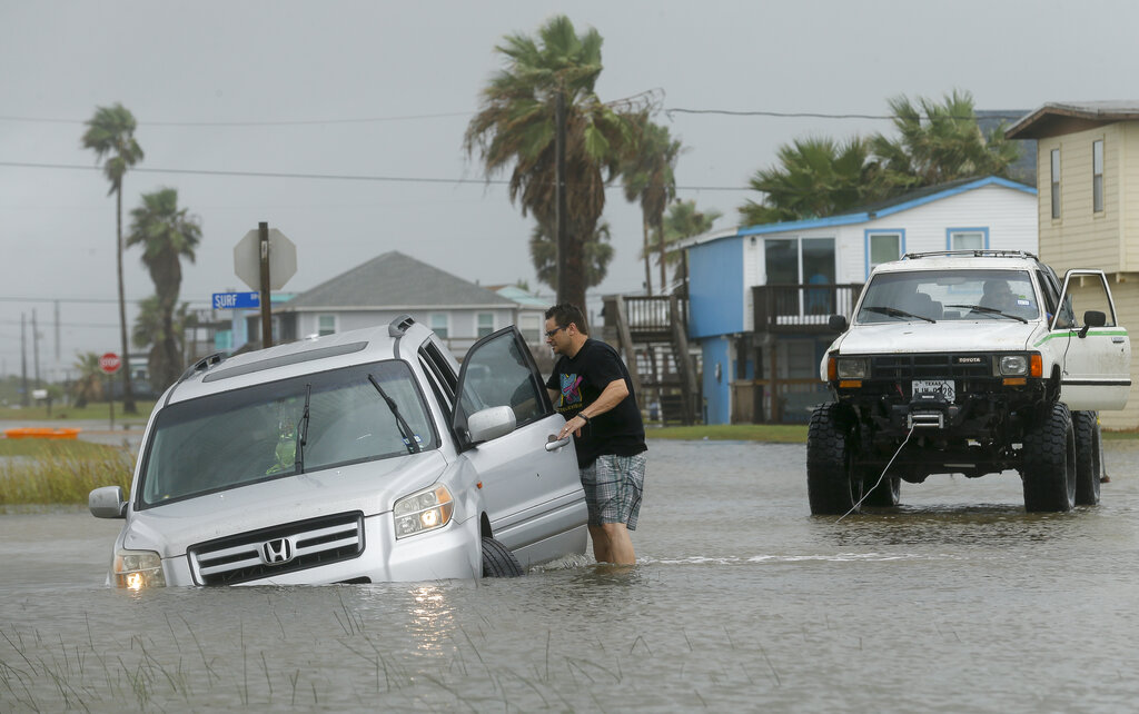 Guy going to his car amid flooding