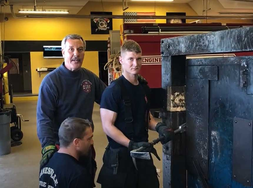 Mike Ciampo with firefighters working on a forcible entry prop
