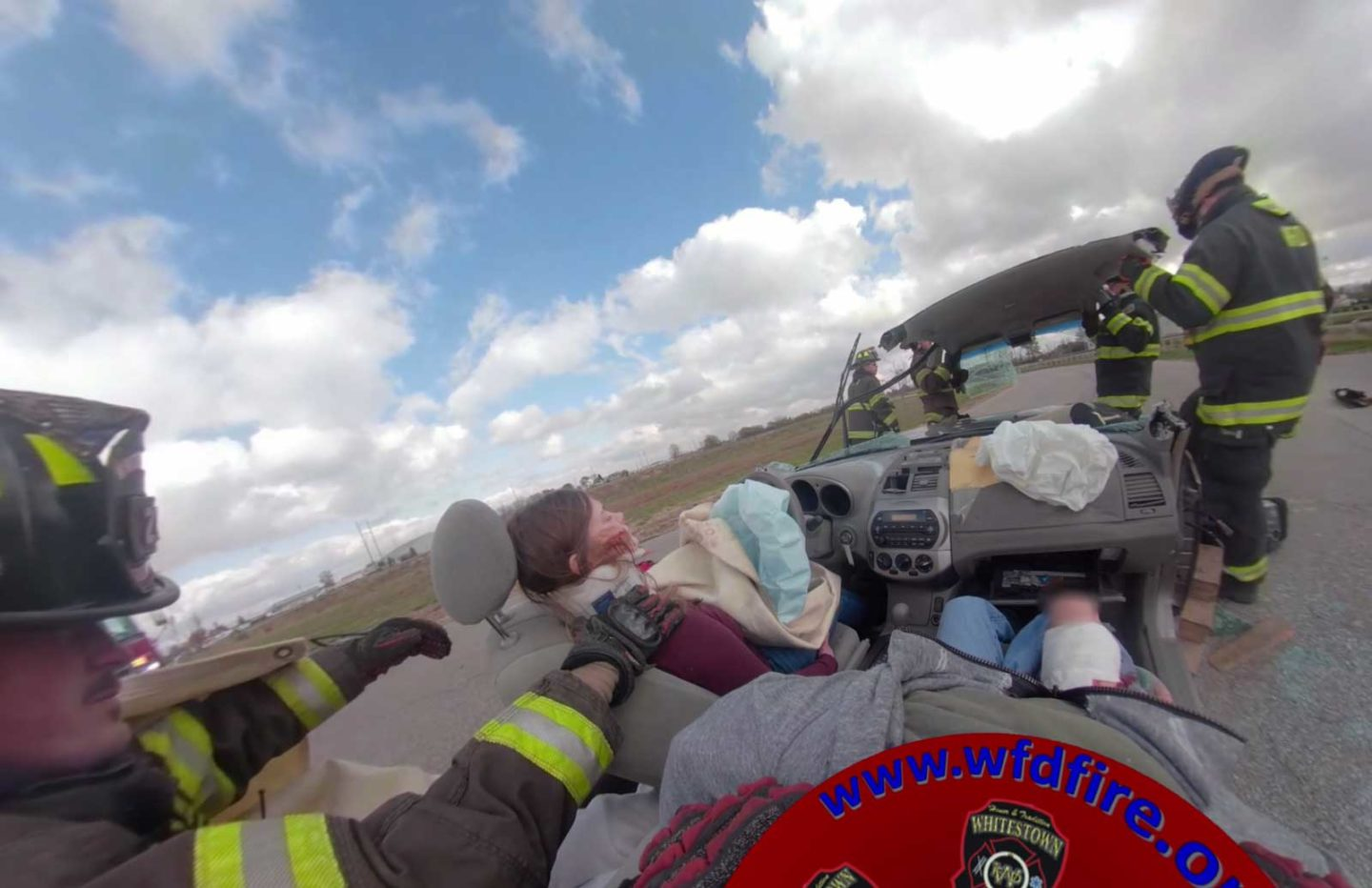 Virtual reality frame of firefighters responding to vehicle accident