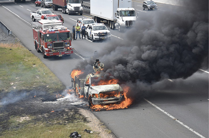 Firefighters responding to a vehicle fire