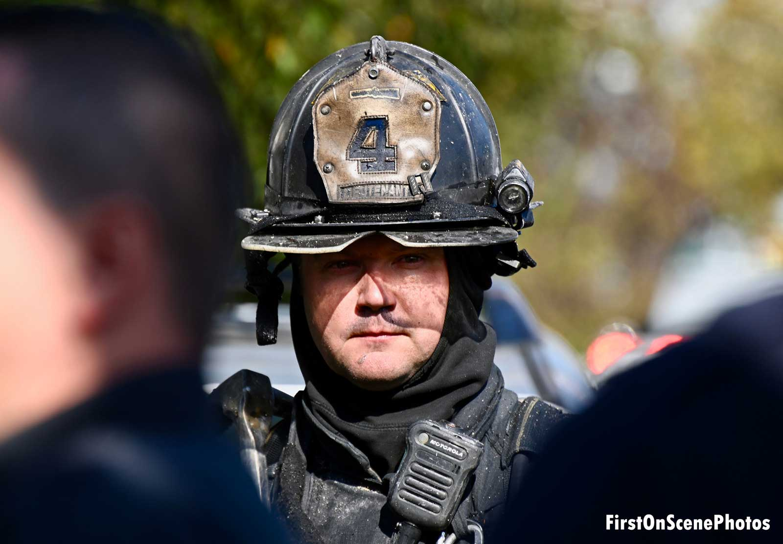 Firefighter at the scene of a fire in Queens, NY
