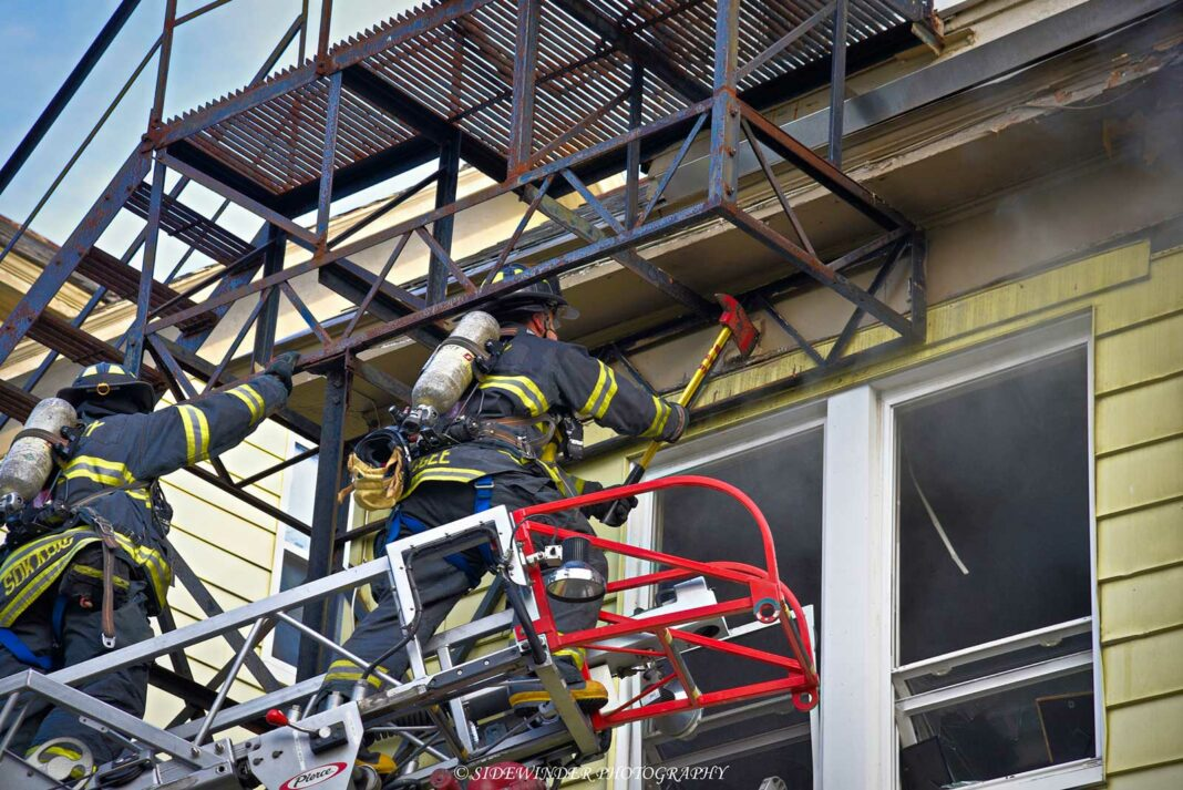 Firefighters work at the scene of a fire that left one member injured in Albany, New York