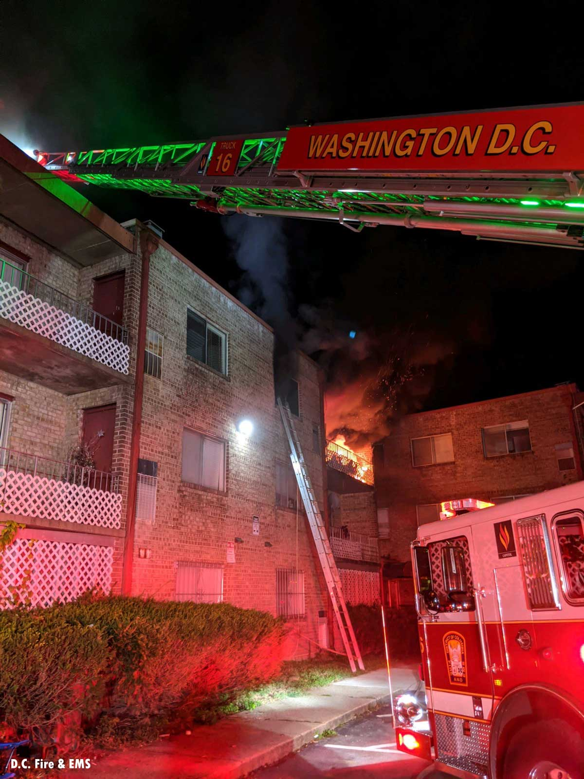 Aerial device and fire showing at D.C. apartment fire