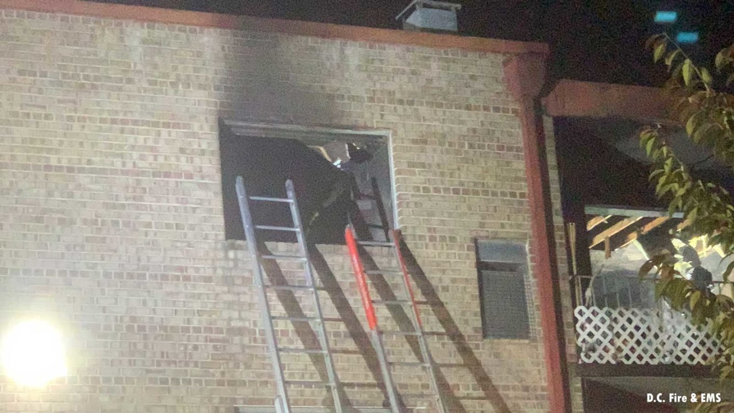 Portable ladders set up to a window on the fireground