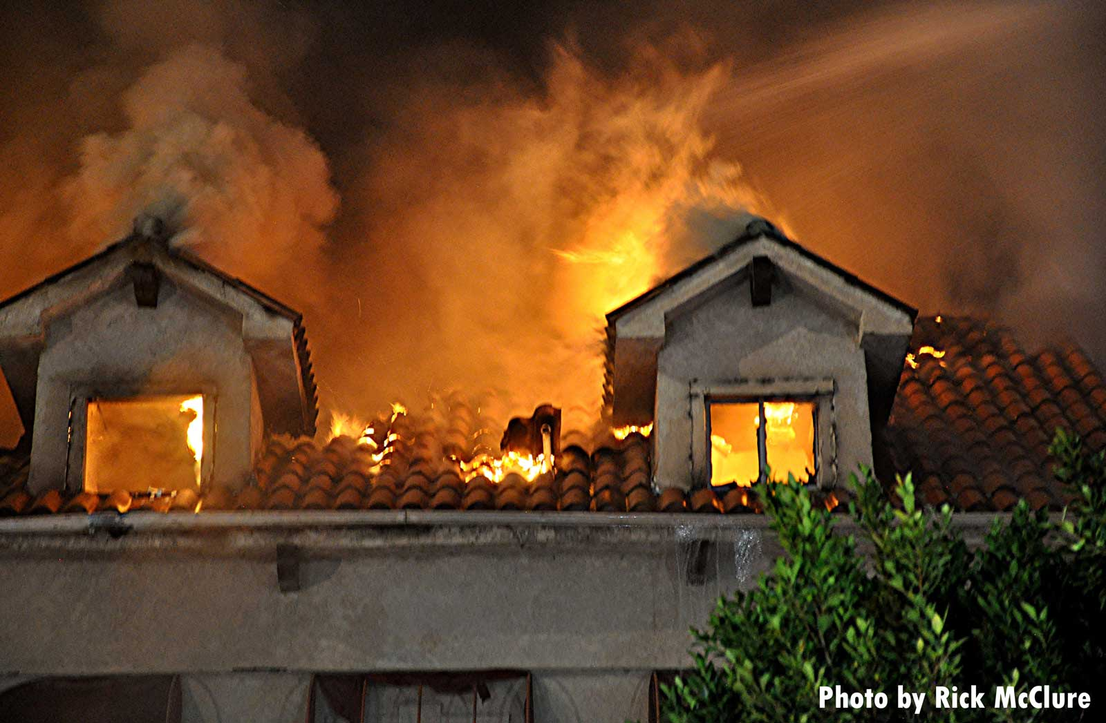 Fire and smoke lights up windows of the building