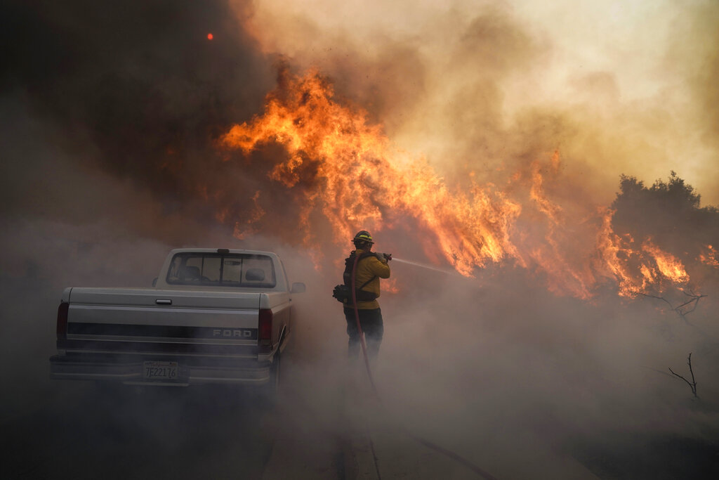 Firefighter Raymond Vasquez battles the Silverado Fire