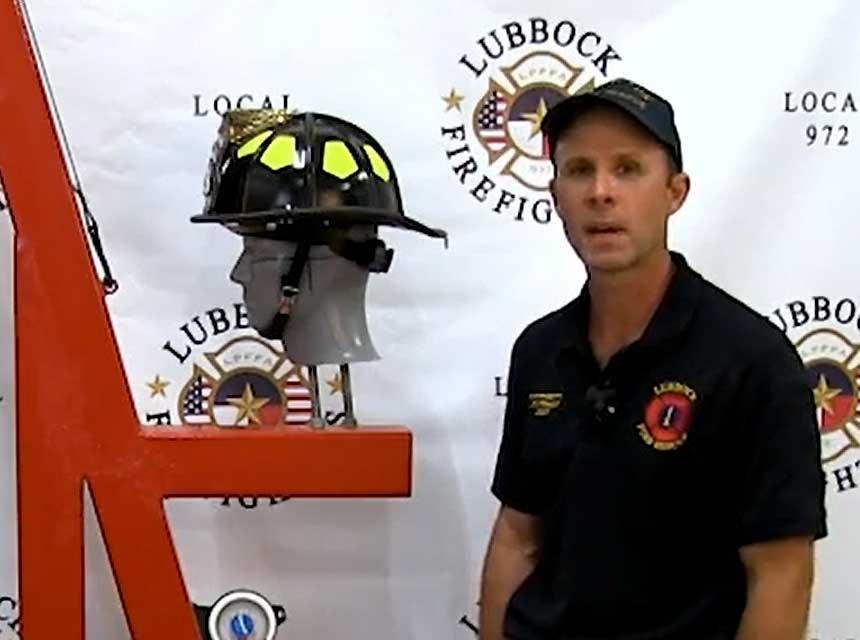 Brady Robinette and a fire helmet
