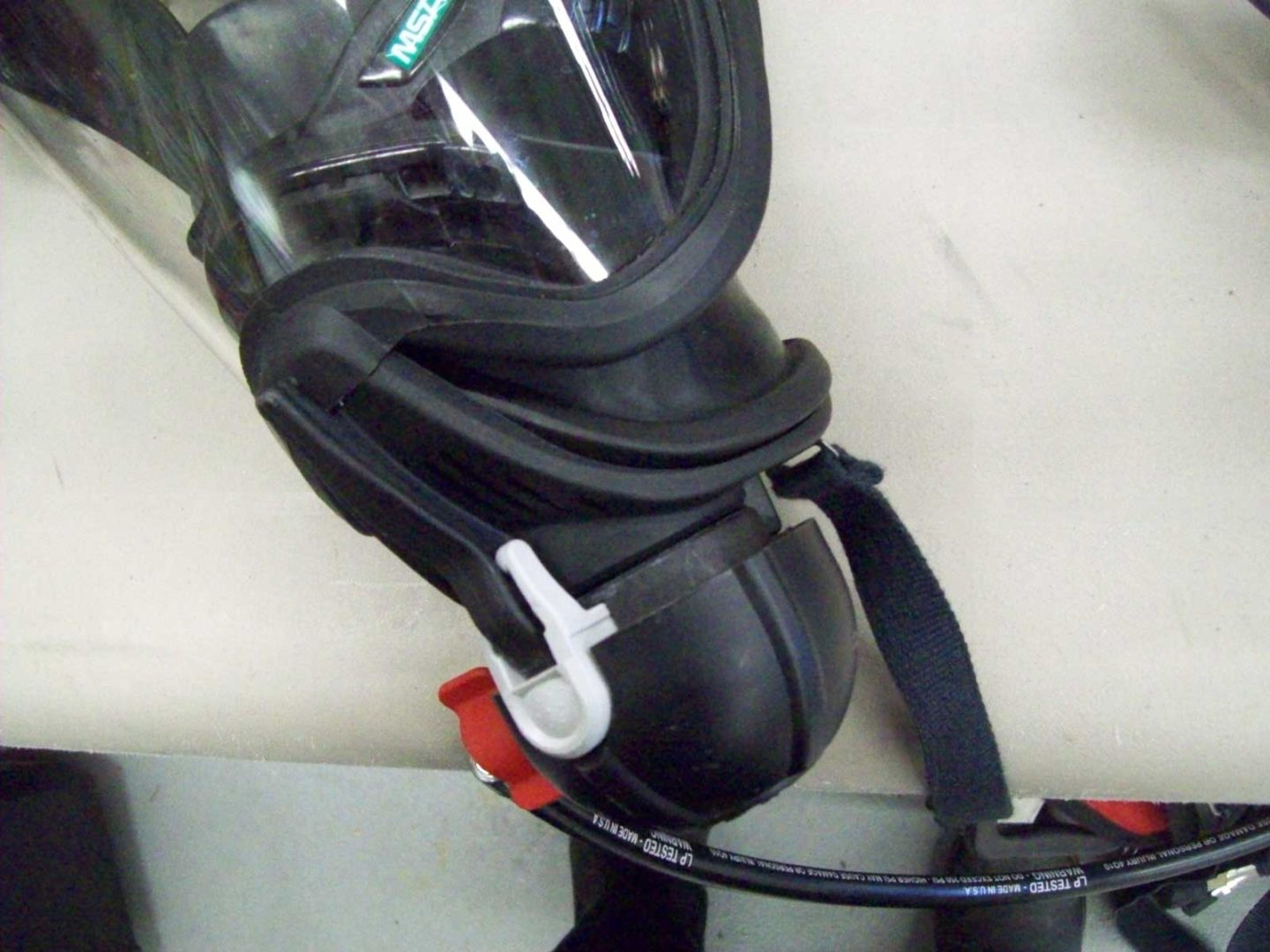 SCBA mask-mounted regulator connected to a face piece
