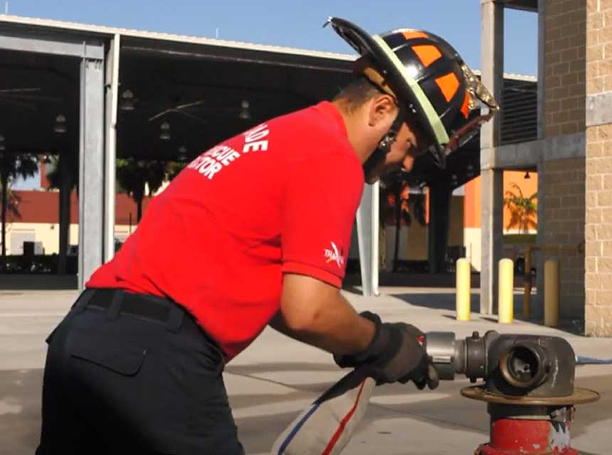Firefighter attaching a hoseline to FDIC