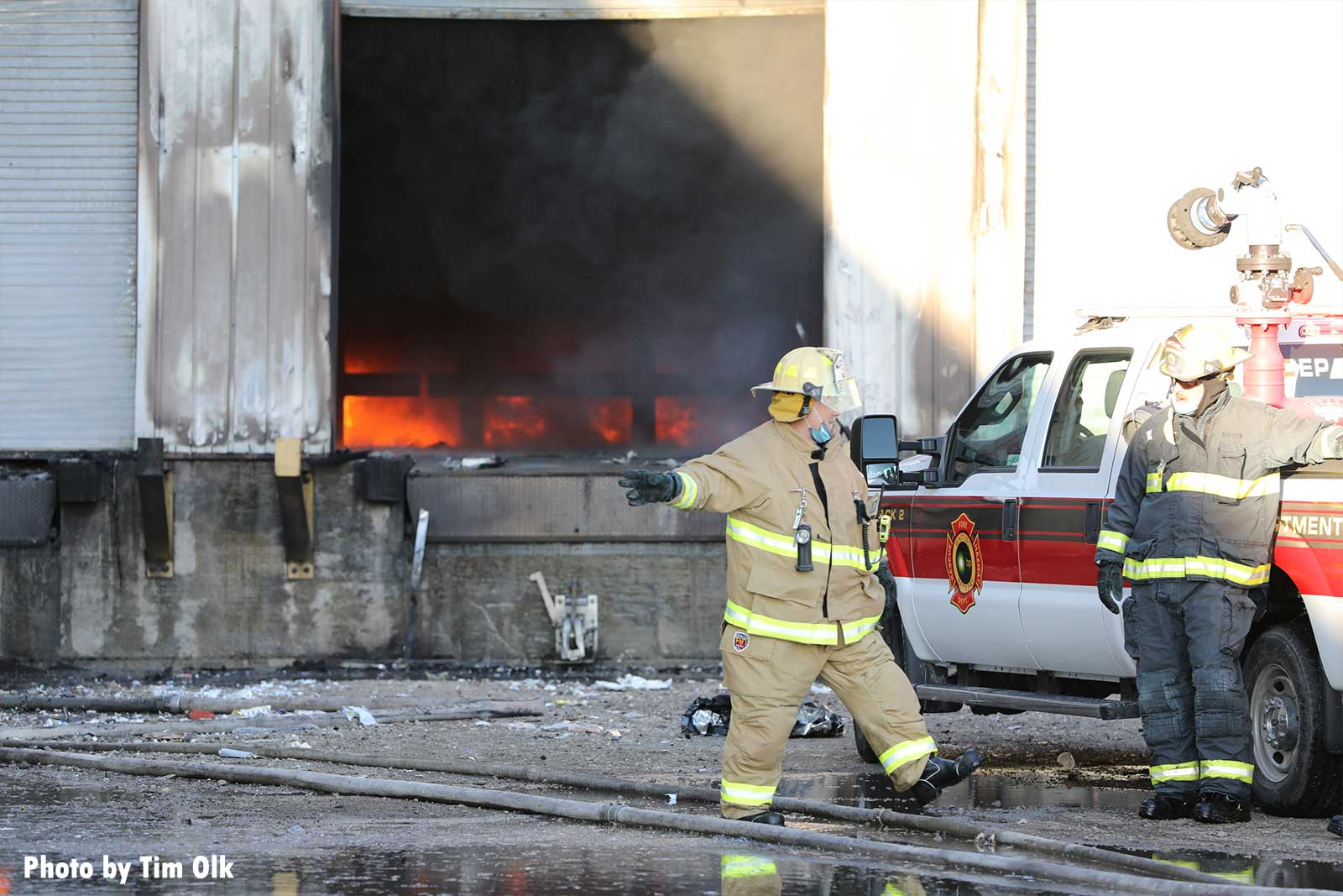 Firefighters with flames inside a loading dock