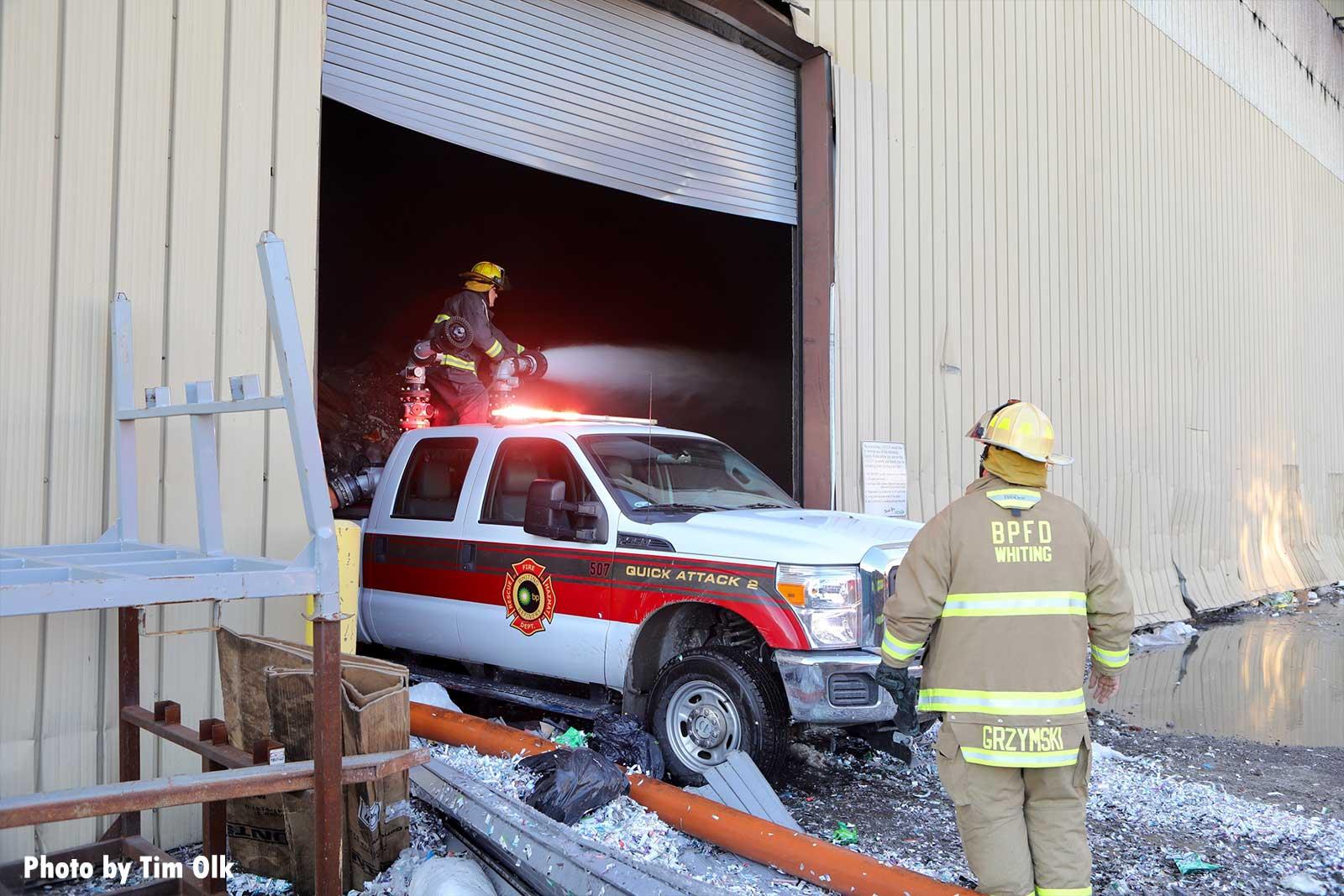 Firefighter on truck backed inside building