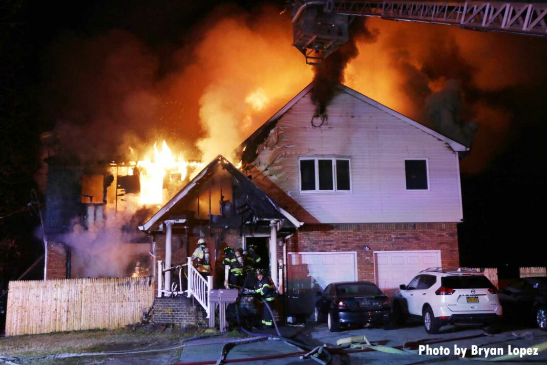 Flames shoot from a home on Long Island