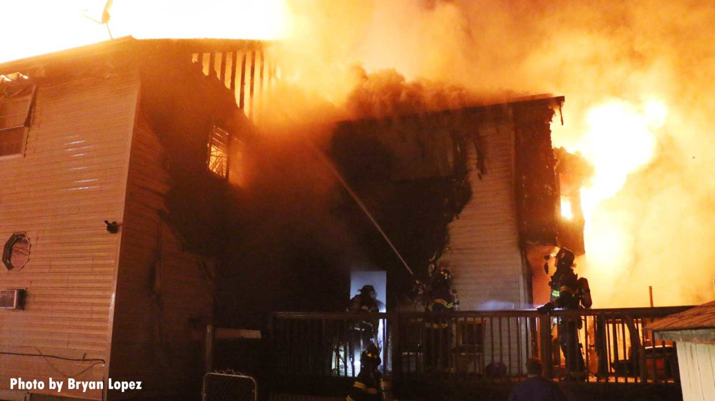Firefighters responding to a house fire on Long Island that injured four people, including a firefighter