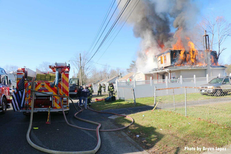Firefighters arrive on scene at Long Island fire