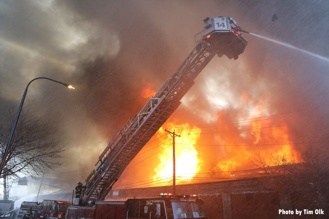 Chicago tower ladder flowing water onto commercial fire