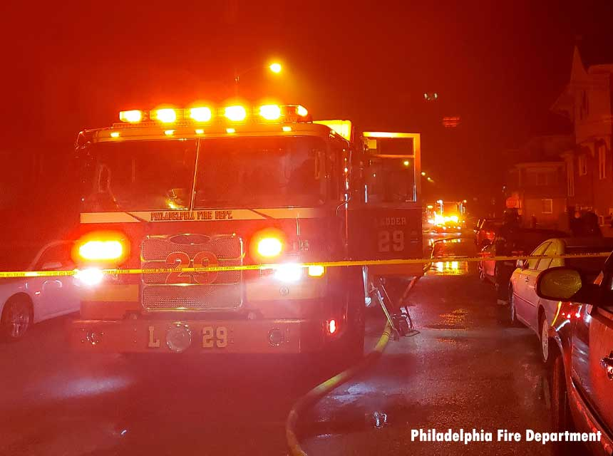 Philadelphia fire truck at the scene of a fatal house fire