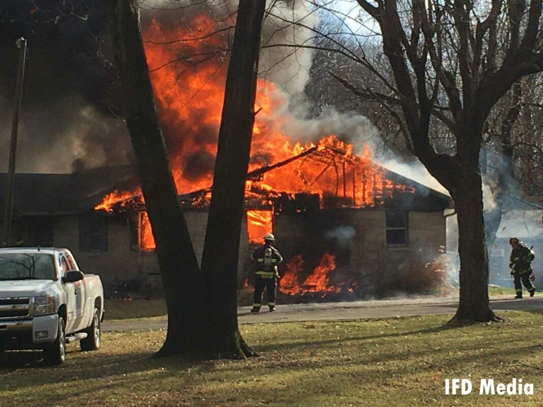 Massive flames shoot from a home in Indianapolis