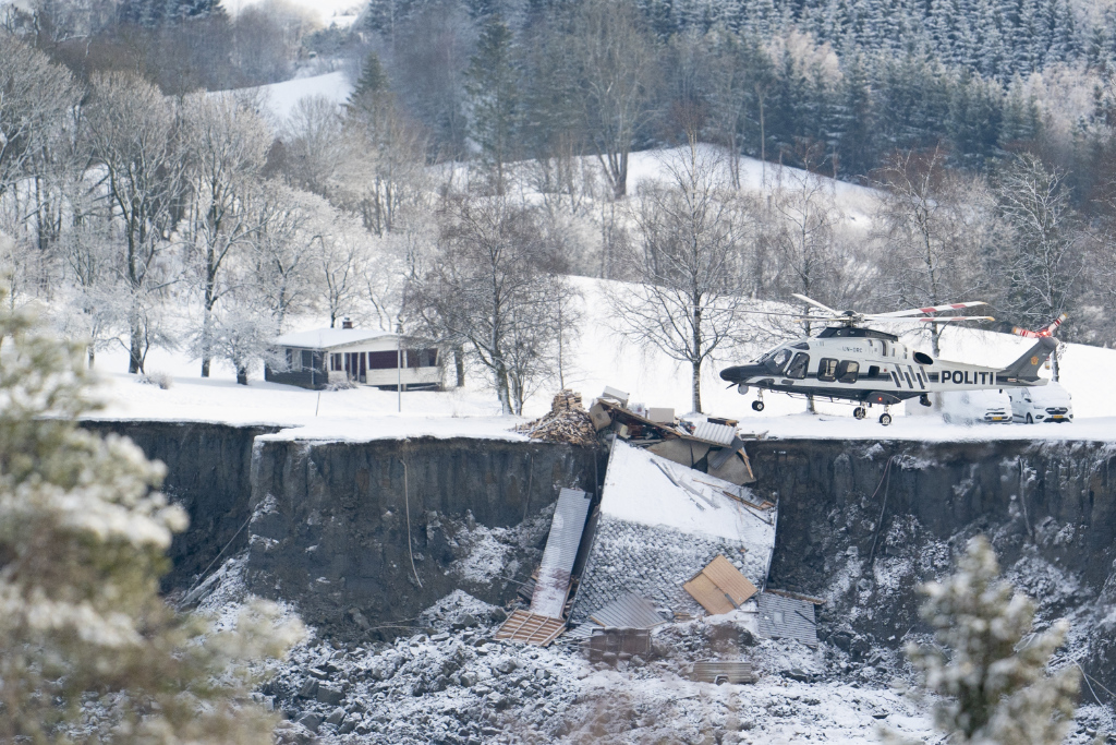 Emergency services near the site of a landslide in Ask, northeast of Oslo, Thursday, Dec. 31, 2020. A landslide smashed into a residential area near the Norwegian capital Wednesday.