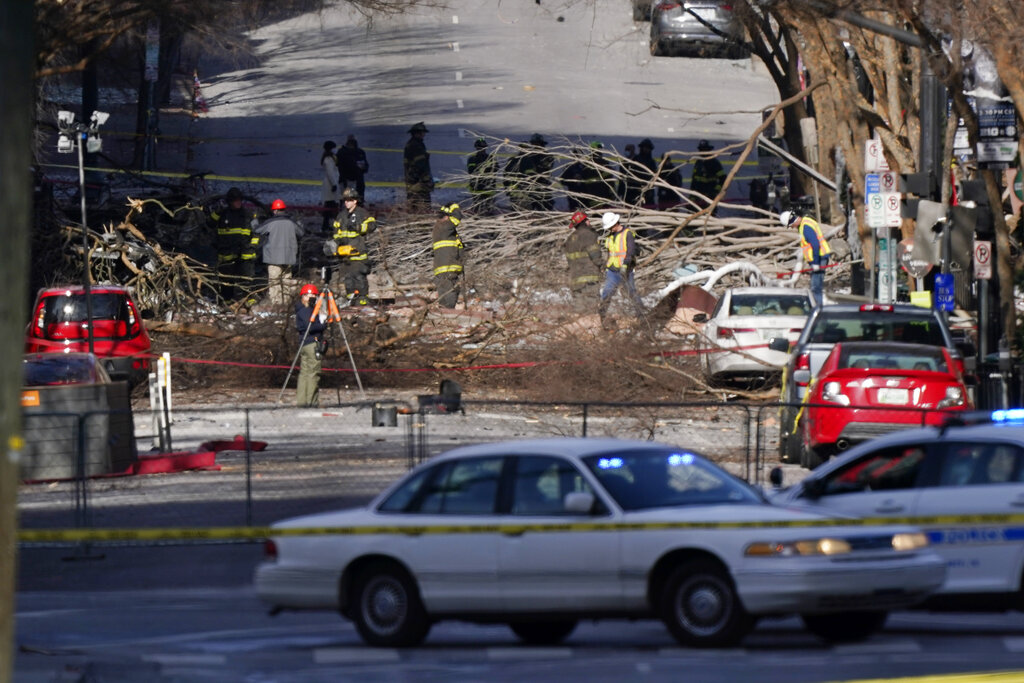 Firefighters search debris after Nashville explosion