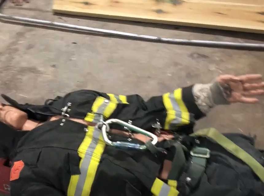 Dummy in firefighter gear with straps