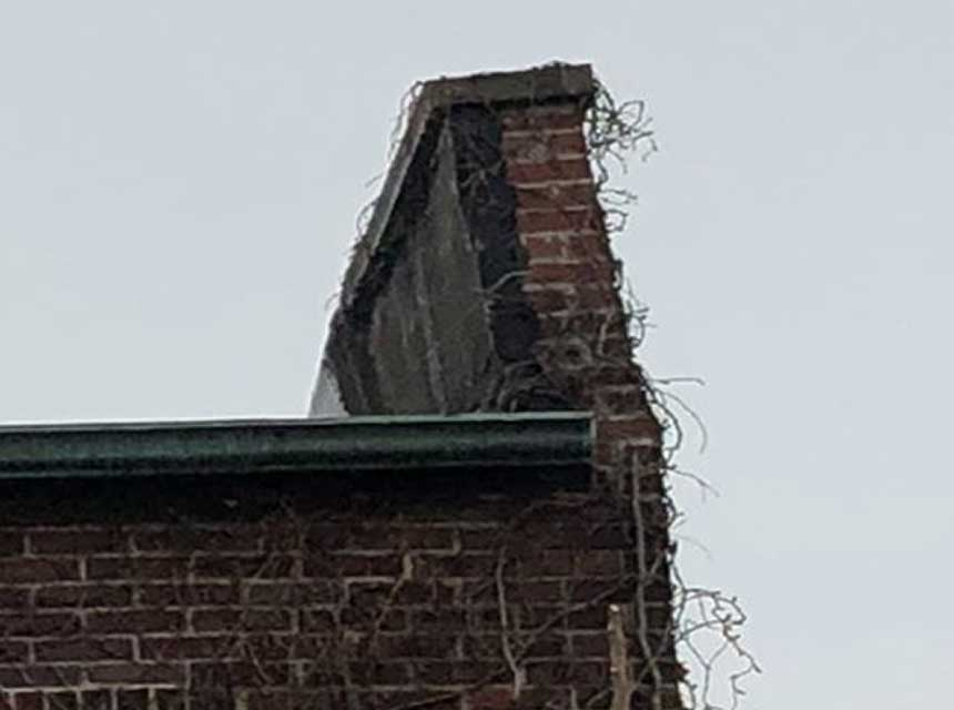 Parapet warped due to the elements
