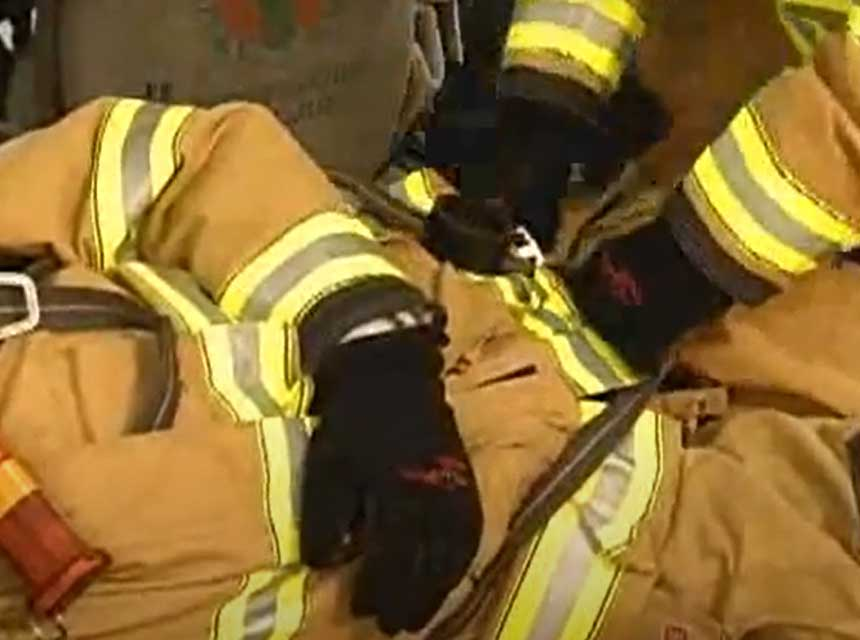 Use of personal harness on bunker gear to remove firefighter
