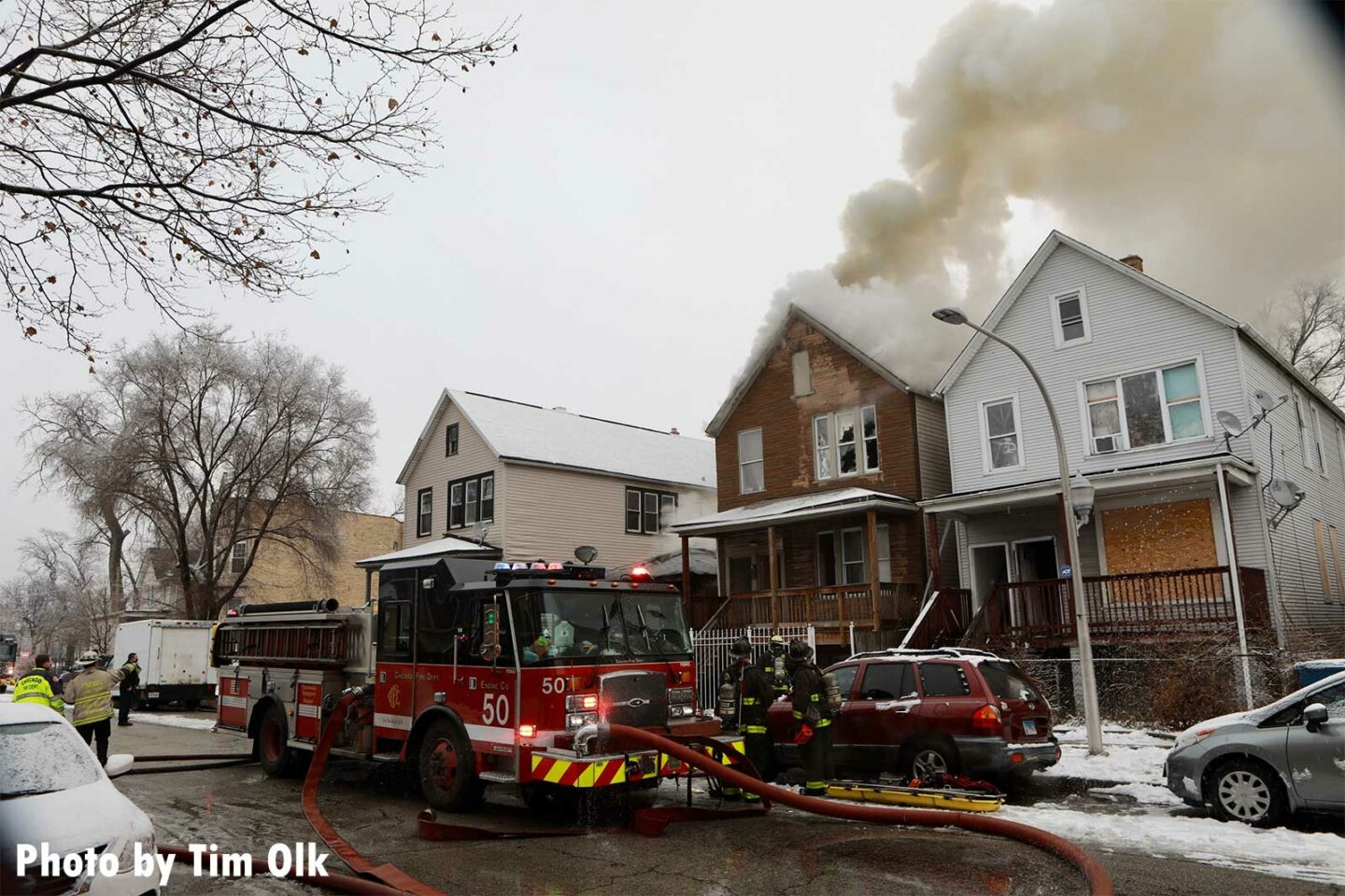 Smoke coming from the top of a house fire in Chicago