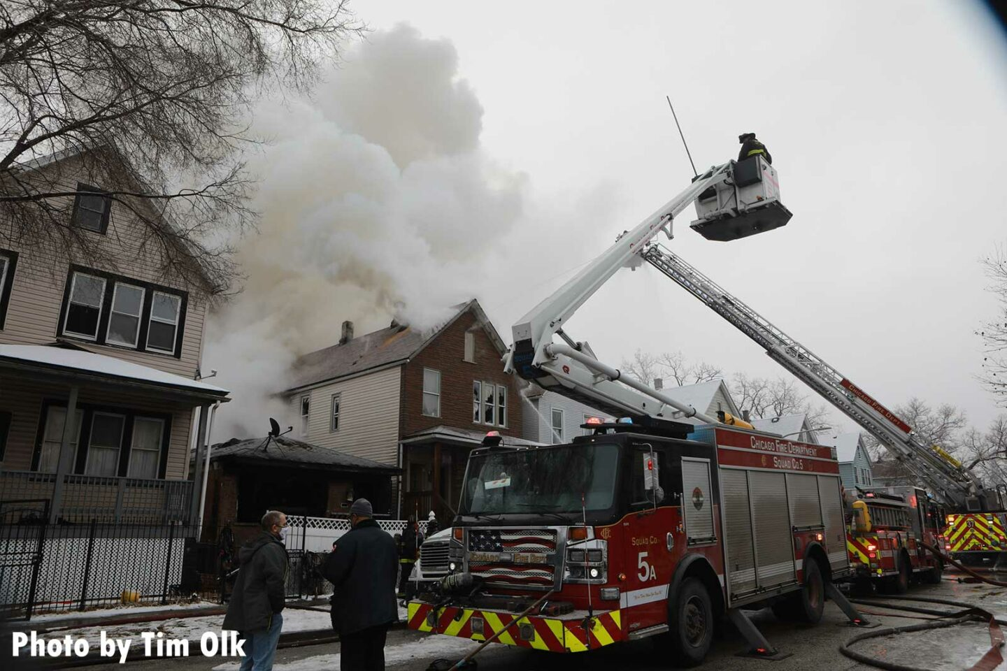 Chicago Squad 5 and tower ladder at a house fire