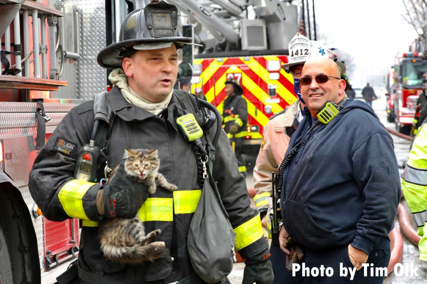 Chicago firefighters with a rescued kitten at a house fire
