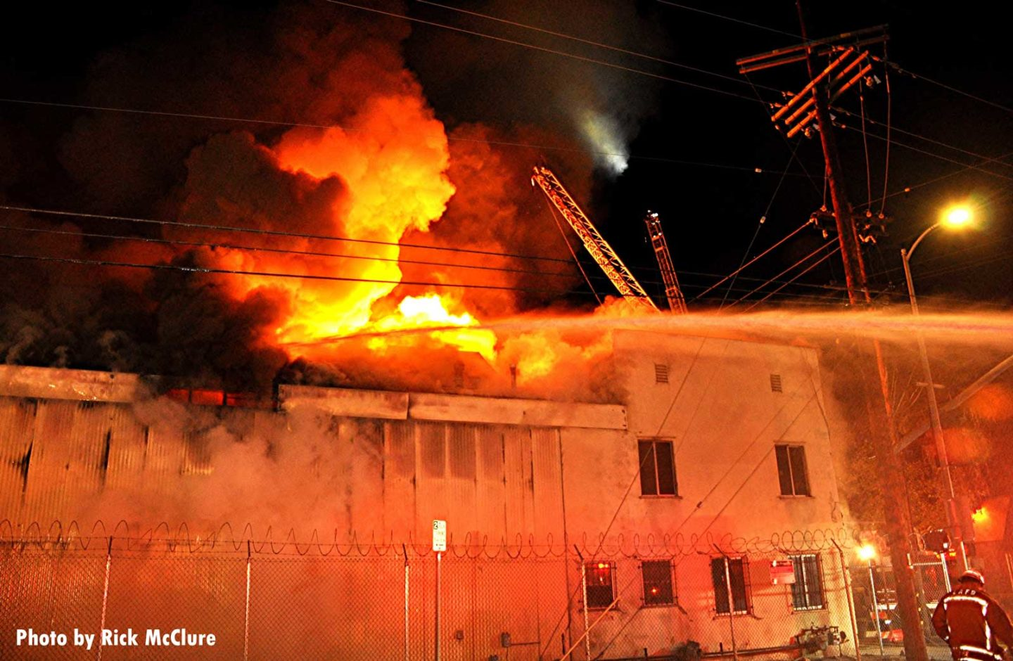 Flames shoot from the roof of the building in Los Angeles