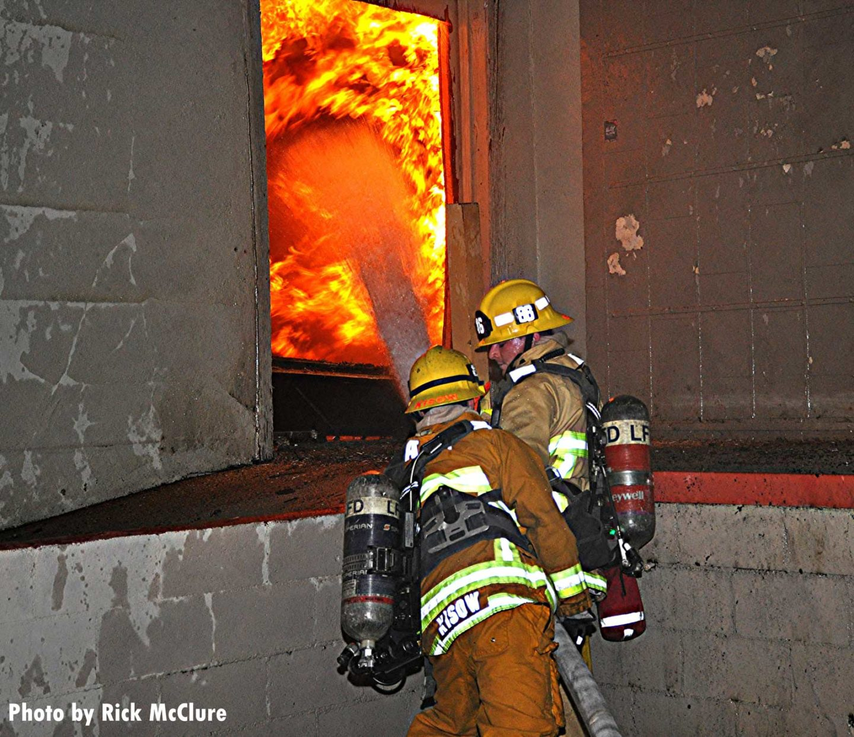 Flames seen through a door as Los Angeles fires put water through the doorway