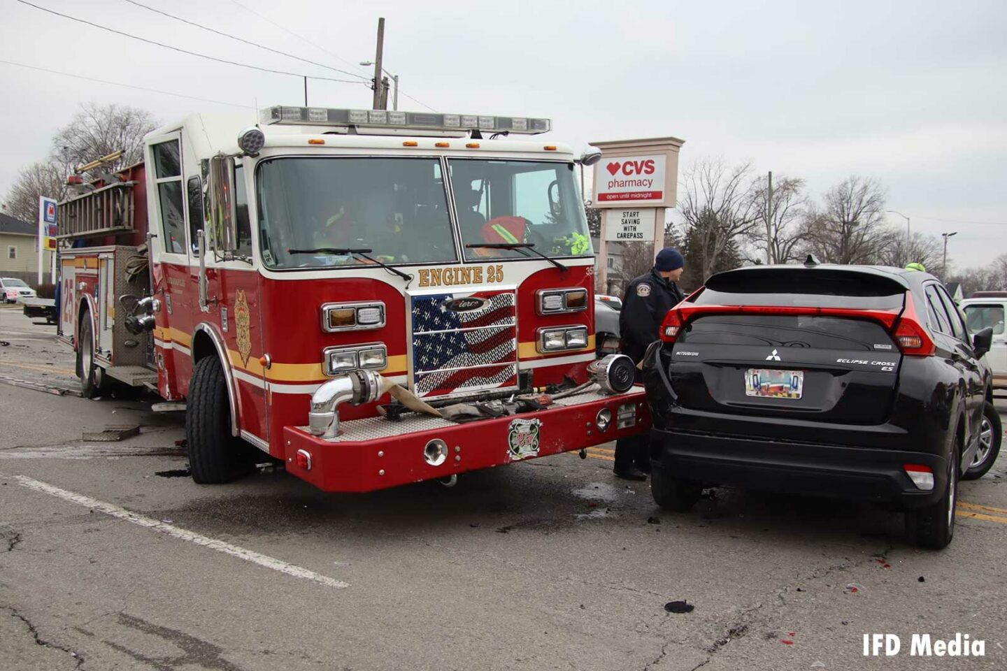 Indianapolis fire apparatus involved with car