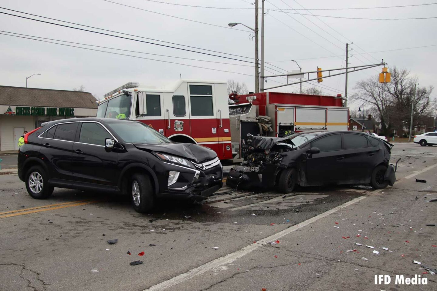 Two smashed vehicles after an accident involving an Indy fire truck