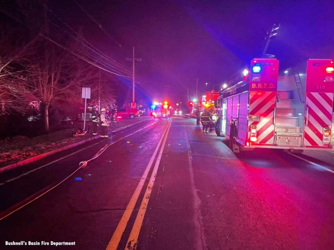 Firefighters and apparatus on scene Perinton NY house fire