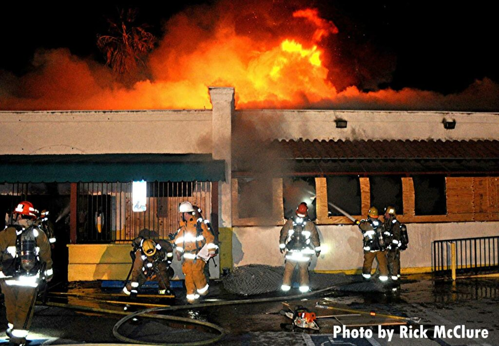 LAFD firefighters at the scene of a raging fire in a boarded-up restaurant