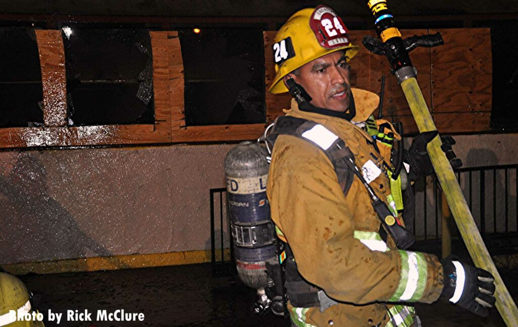 LAFD firefighter with a charged hoseline