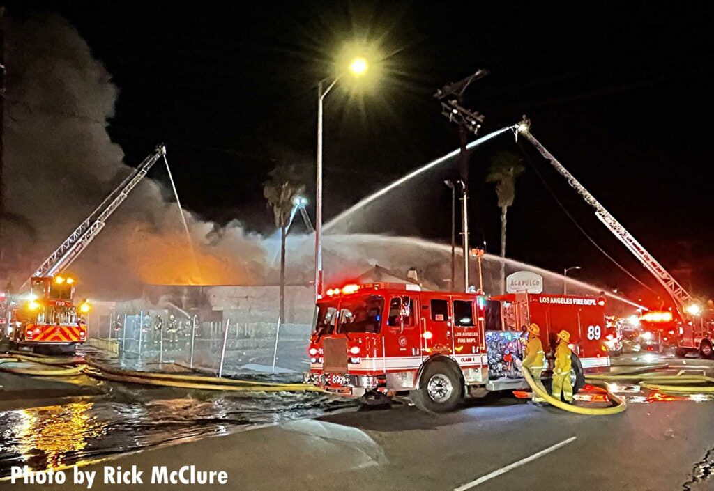 Multiple LAFD rigs and aerial streams at structure fire
