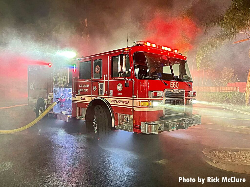A City of Los Angeles fire truck pumping at the fire