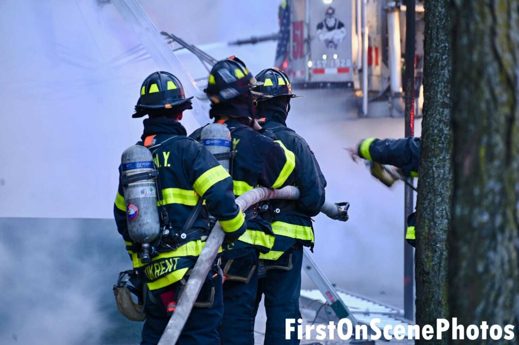 FDNY firefighters on a hoseline at three-alarm Bronx fire