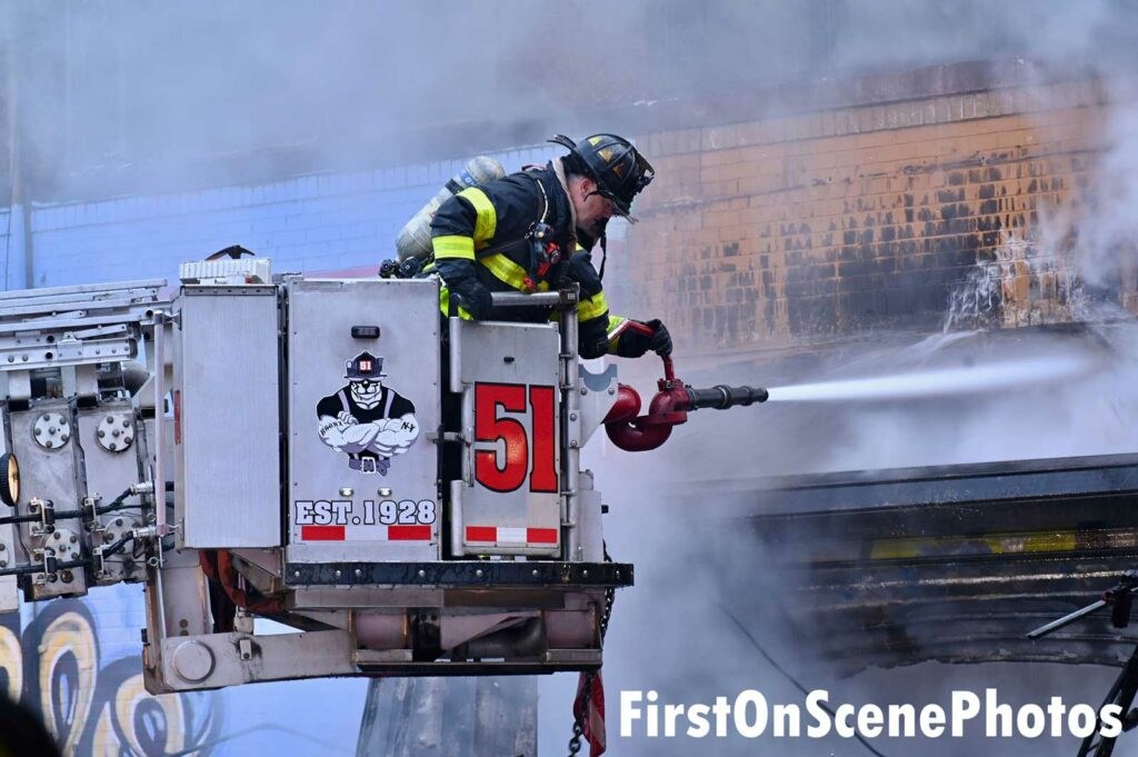 FDNY firefighter in a bucket at Bronx fire