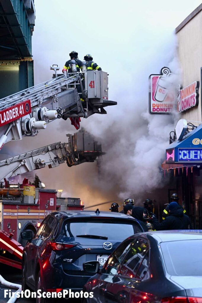 Multiple aerials in use as firefighters are enveloped in smoke from three-alarm Bronx fire