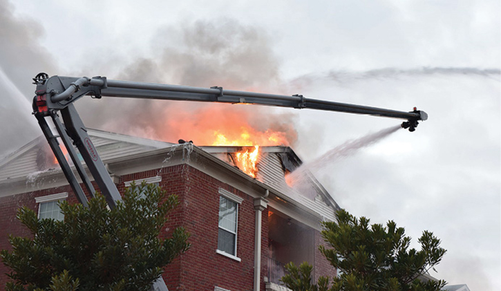 Flames shoot through roof of home as aerials work