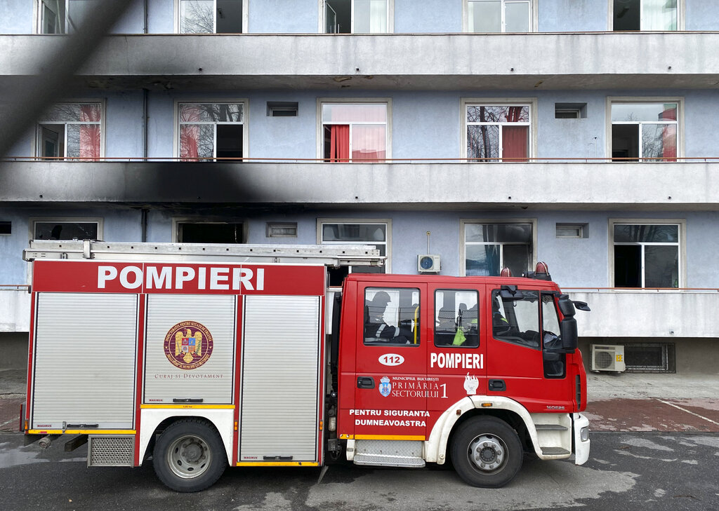 Firefighters at Romania hospital fire