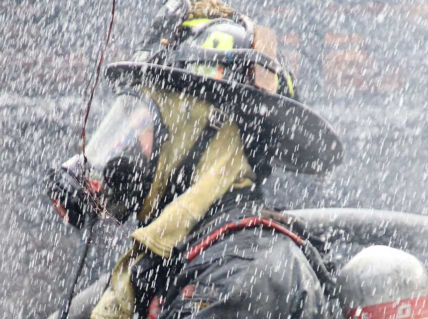 Indianapolis firefighter with full SCBA and face piece