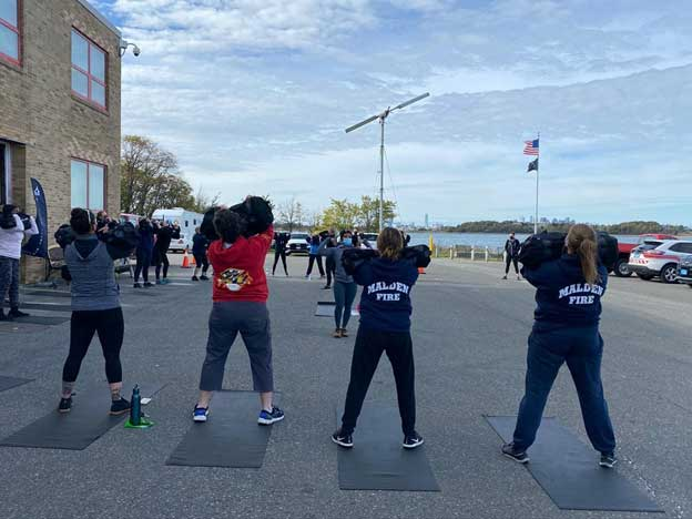 Members from various departments participate in physical fitness training